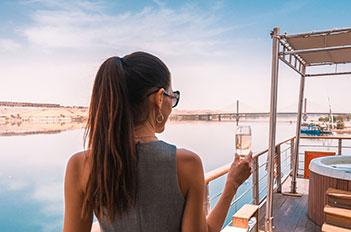 girl at luxor and aswan nile cruise egypt